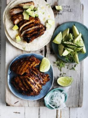 Adobo-marinated chicken tacos. Photo: William Meppem