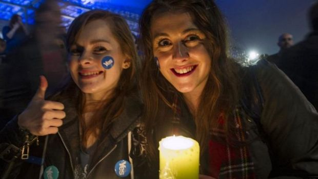 Pro-independence supporters gather at the Scottish Parliament in Edinburgh.