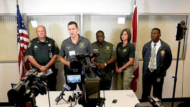 Sheriff Robert Schultz, second from left, at a news conference after the Bell shooting.