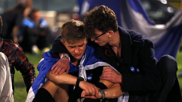 "Distraught ""Yes"" supporters comfort each other in George Square, Glasgow."