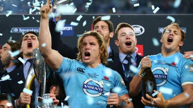 Triumphant Tahs: Michael Hooper celebrates after winning the Super Rugby title.
