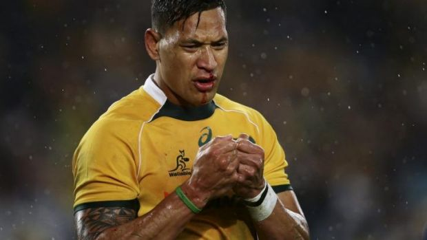 The claret flowed: Israel Folau feels the pain against the All Blacks in Sydney last month.