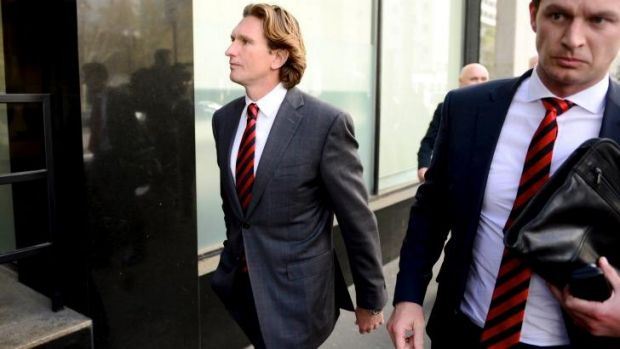 James Hird leaves the court on Friday after the ruling went against him and the club.