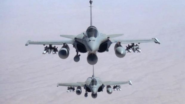 Two Rafale jet fighters fly over Iraq Friday. Photo supplied by the French Army's video and photo department
