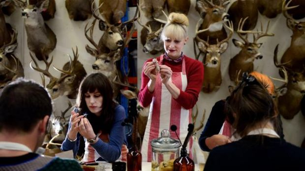 Natalie Delaney-John (standing) teaches one of her taxidermy classes.