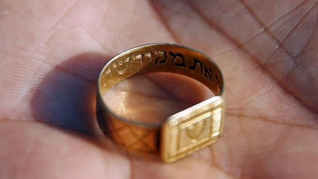 A golden ring with a Hebrew inscription is shown after being discovered at the Nazi's Sobibor death camp. Many personal ...