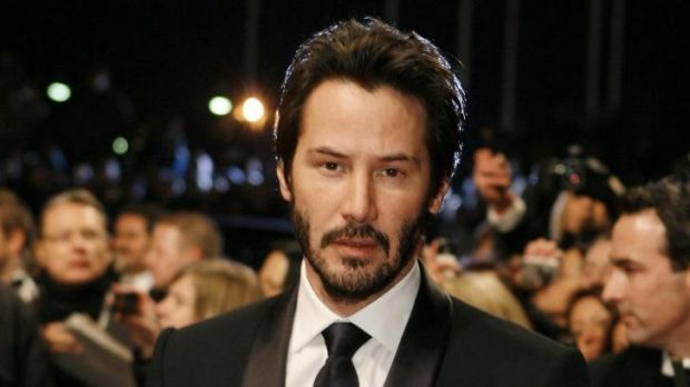 Cool customer ... Keanu Reeves may not have recommended any books in his library but had no problem chatting to the intruder.