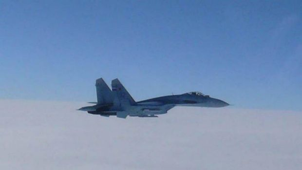 A Russian SU-27 flies over the sea near Japan last year.