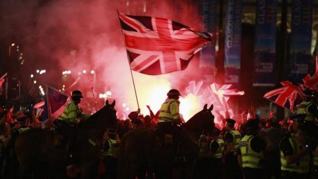 Police stand guard while Union loyalists clash with independence campaigners in Glasgow's George Square.