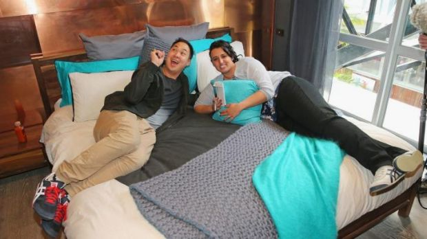 Chris Susetio and Jenna Susetio lie on the bed of their finished apartment as part of The Block Glasshouse. .