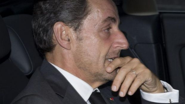 Nicolas Sarkozy leaves his office on Friday after announcing his return to politics on Facebook and Twitter.