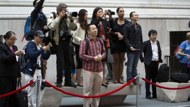 Media and Chinese tourists look out for Jack Ma outside the New York Stock Exchange on Friday.