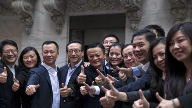 Jack Ma (centre) with Alibaba employees at the New York Stock Exchange.