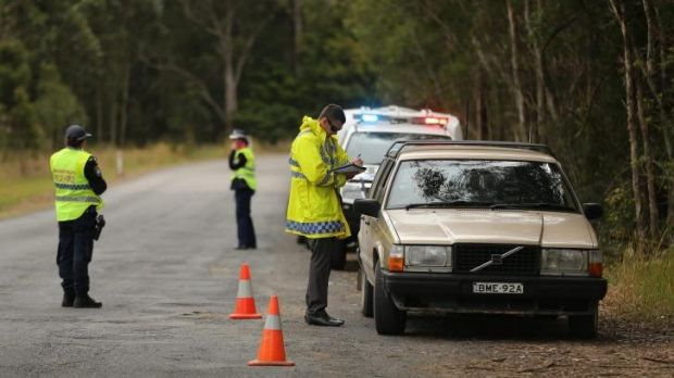 NSW Police stop and question motorists at a checkpoint on the outskirts of Kendall.