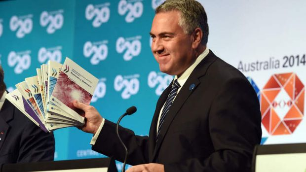 Optimistic: Treasurer Joe Hockey  holds up a report during a press conference at the G20 Finance Ministers and Central ...