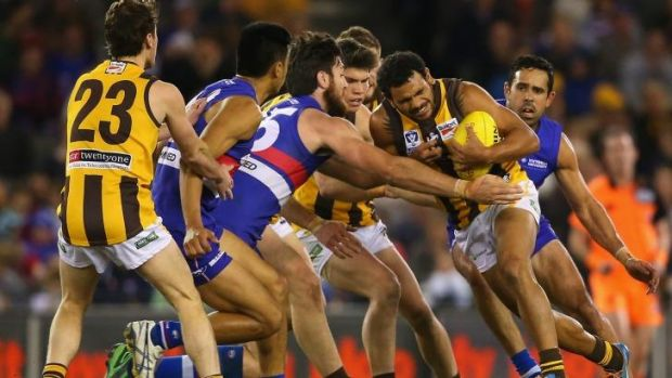 Cyril Rioli comes up against Footscray defenders during the VFL grand final on Sunday.