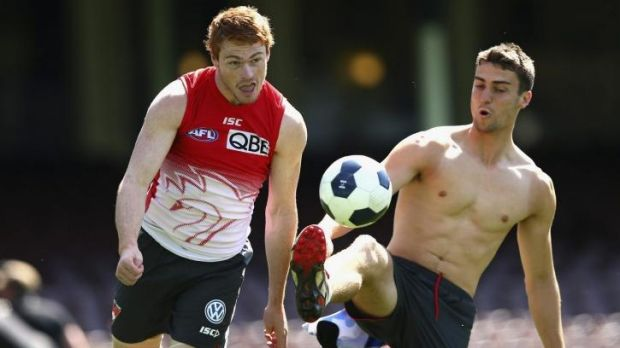 Having a ball: Gary Rohan and Xavier Richards train last week ahead of the Swans' victorious grand final qualifier ...