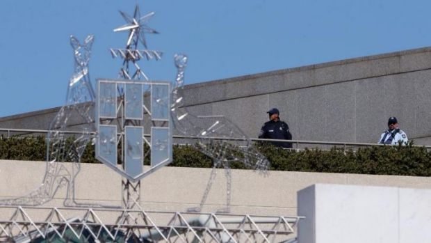 Australian Federal Police officers patrol Parliament House on Friday.