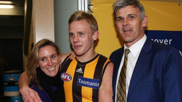 Will Langford celebrates winning his first game with dad Chris (right) and mum Eleanor.