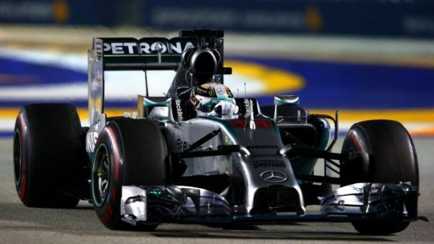 Night rider: Lewis Hamilton on his way to victory in Singapore and the formula one championship lead.