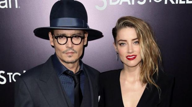 Latest hacking victim: actress Amber Heard with Johnny Depp.