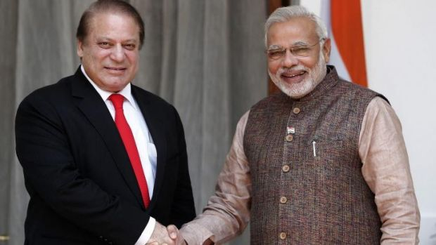 Border tensions: Pakistani Prime Minister Nawaz Sharif, left, shakes hands with Indian Prime Minister Narendra Modi in May.