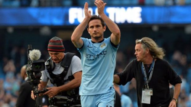 Lampard applauds the Chelsea supporters after scoring against his former club.