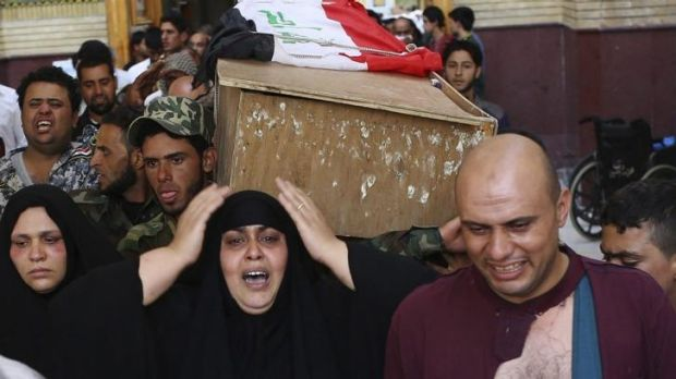 Mourners carry the coffin of a Hezbollah Iraq fighter, who was killed during clashes north of Baghdad with the Islamic State.