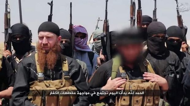 An image allegedly shows members of Islamic State, including Abu Omar al-Shishani (left) and ISIL sheikh Abu Mohammed ...