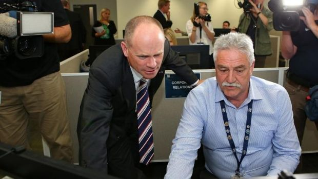 Premier Campbell Newman and Mick Smith, CCTV manager, meet at the G20 operations room at Brisbane Airport.