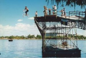 Teenagers experience the thrill of the Birdman Rally launch platform on Lake Burley Griffin after competition finish in 1987.