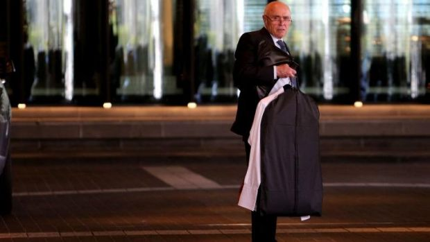 While rivals are getting shirty, Essendon chairman Paul Little arrives for a meeting of AFL presidents on Monday.