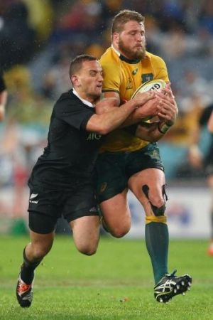 James Slipper takes Aaron Cruden along for the ride in Bledisloe I this year.