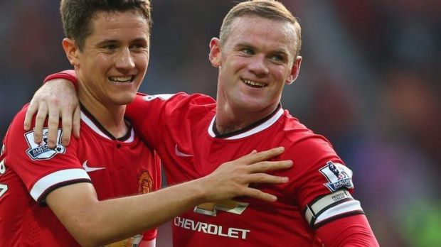Wayne Rooney celebrates with teammate Ander Herrera after scoring his second goal this season against QPR.