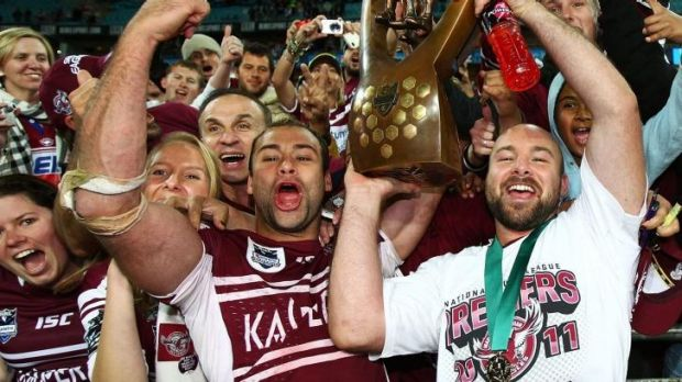 Brothers in arms: Brett and Glenn Stewart celebrate a premiership in 2011.