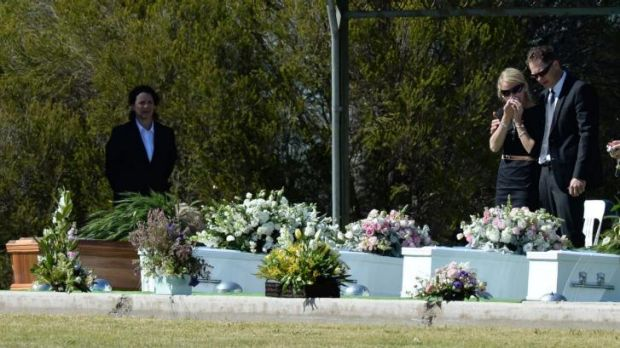 Kim Hunt's sister Jenny Geppert grieves over the coffins of Geoff and Kim Hunt and their children Fletcher, Mia and ...