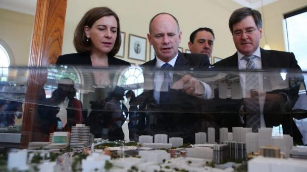 Queensland Premier Campbell Newman inspects the plans for Brisbane's showgrounds.