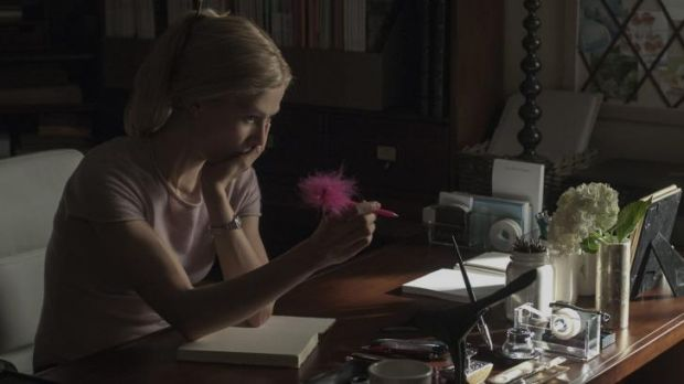 Girl interrupted: Rosamund Pike as Amy considers one of her diary entries in <i>Gone Girl</i>.
