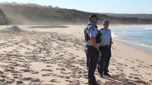 Police at Terrace Beach, where a sand dune collapsed on 10-year-old Byron Gordon on Monday.