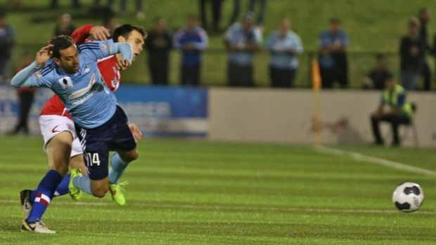 Tense affair: Sydney FC striker Alex Brosque is fouled by a Sydney United player.