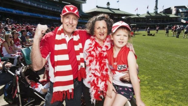 Sydney Swans fans Peter Thomas, his wife Maree and their granddaughter Elena at the team's training session at the SCG.