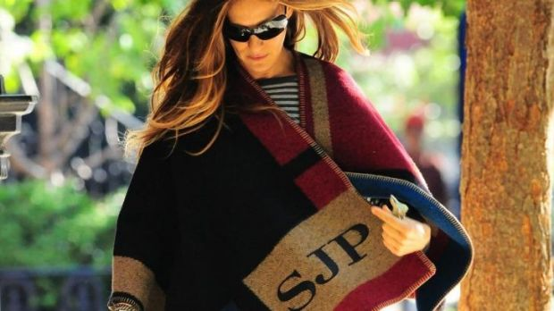 Sarah Jessica Parker does Normcore in a monogrammed Burberry Prorsum blanket cape.