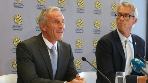 All ears: FFA CEO David Gallop (right) listens to newly appointed technical director Eric Abrams in Sydney on Wednesday.