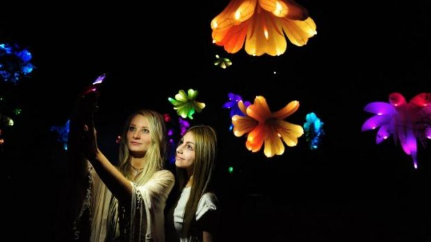 Commonwealth Park will come to life after dark for Floriade NightFest. Talia Liolios, left, of Chisholm, and Laura Mann, ...