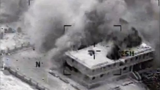 Video released by US Central Command shows a building in Tall Al Qitar, Syria, moments after a US airstrike.