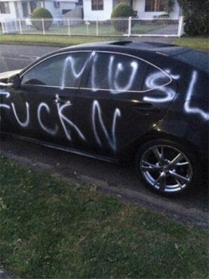A car which was damaged overnight with anti-Muslim slogans in Sydney.