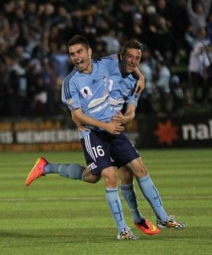 Announcing himself: Christopher Naumoff celebrates one of his two goals for Sydney FC during Tuesday's FFA Cup win over ...