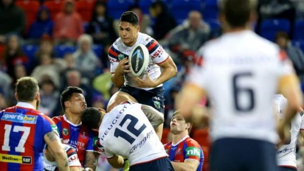 High flyer: Roger Tuivasa-Sheck takes off for the Roosters.
