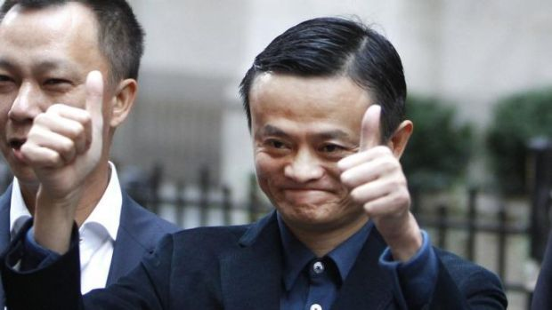 Thumbs up: Alibaba boss Jack Ma poses outside the New York Stock Exchange. But buying into the Chinese e-commerce stock ...