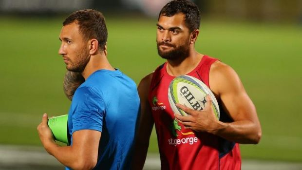Let's get physical: Quade Cooper (left) with Karmichael Hunt at Reds training last week.